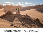 Young Asian Couple Standing Together on Top of the Hill, Valle de La Luna, Atacama Desert, Chile