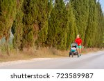 running mother with child in... | Shutterstock . vector #723589987