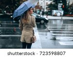 beautiful woman with umbrella... | Shutterstock . vector #723598807