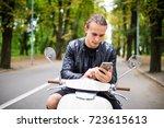 handsome happy man sitting on... | Shutterstock . vector #723615613