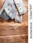 money isolated on a wooden... | Shutterstock . vector #723667597