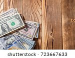 money isolated on a wooden... | Shutterstock . vector #723667633