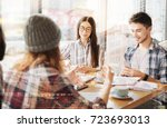 positive students sitting at... | Shutterstock . vector #723693013