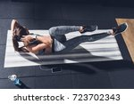 overhead view of athletic woman ... | Shutterstock . vector #723702343
