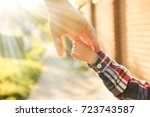 the parent holding the child's... | Shutterstock . vector #723743587