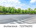 asphalt road and green forest | Shutterstock . vector #723796393