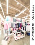 Small photo of Blurred image sport and fitness department in clothing store in America. Activewear shop with mannequin on sportswear and wardrobe showcase of athletic shoes, gear, apparel. Healthy lifestyle concept