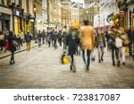 man   women shopping on busy... | Shutterstock . vector #723817087