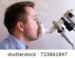 young man testing breathing... | Shutterstock . vector #723861847