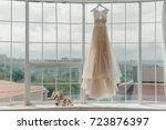the bride's dress hangs on the... | Shutterstock . vector #723876397