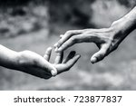 one human hand helping another... | Shutterstock . vector #723877837