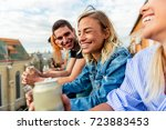 friends on rooftop party at... | Shutterstock . vector #723883453