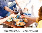 hands friends toasting red wine ... | Shutterstock . vector #723894283
