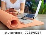 relax at work concept. yoga mat ... | Shutterstock . vector #723895297