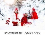 children with christmas tree on ... | Shutterstock . vector #723947797