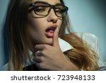 seductive blonde in glasses... | Shutterstock . vector #723948133