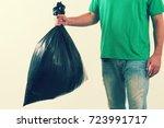 man holding trash garbage.    Shutterstock . vector #723991717