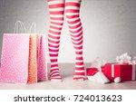 sexy woman legs. christmas... | Shutterstock . vector #724013623