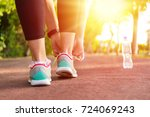 fitness woman tying running... | Shutterstock . vector #724069243