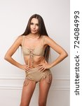 beautiful woman in beige...   Shutterstock . vector #724084993