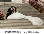 kissing wedding couple sits on... | Shutterstock . vector #724086667