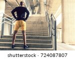 rearview of a man standing with ...   Shutterstock . vector #724087807