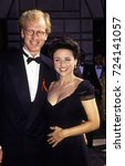 Small photo of LOS ANGELES, CALIFORNIA - Exact date unknown - circa 1991 - Actress Julia Louis-Dreyfus with husband Brad Hall attending a formal celebrity event