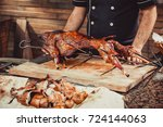 chef hands cutting whole... | Shutterstock . vector #724144063