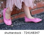 little girl with pink shoes | Shutterstock . vector #724148347
