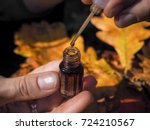 a woman opens the perfume oil.... | Shutterstock . vector #724210567