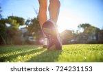 woman runner running in nature  ... | Shutterstock . vector #724231153