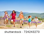 happy kids running together... | Shutterstock . vector #724243273