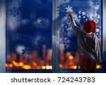boy decorate window for new... | Shutterstock . vector #724243783