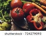 closeup of fresh organic tomato ... | Shutterstock . vector #724279093