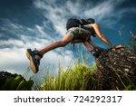 tourist with backpack climbing... | Shutterstock . vector #724292317