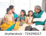 portrait of happy indian family ... | Shutterstock . vector #724298317
