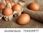 brown chicken eggs in a box for ... | Shutterstock . vector #724310977