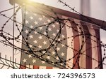 american flag and barbed wire ... | Shutterstock . vector #724396573