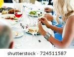young woman holds a glass of... | Shutterstock . vector #724511587