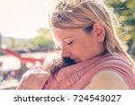 beautiful young mother carrying ... | Shutterstock . vector #724543027