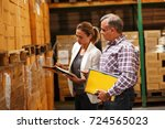 female manager and warehouse... | Shutterstock . vector #724565023