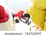 close up of gas gun with car | Shutterstock . vector #724722997