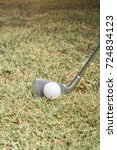 centered golf ball on course in ... | Shutterstock . vector #724834123
