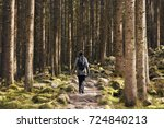 lonely girl walking in the wood ... | Shutterstock . vector #724840213