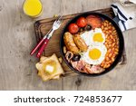full english breakfast in a... | Shutterstock . vector #724853677