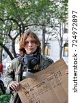 Small photo of PHILADELPHIA, PA OCTOBER 6, 2011 Occupy Wall Street protester holding sign protesting corporate greed.
