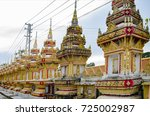 golden stupas on a buddhist... | Shutterstock . vector #725002987