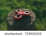red spinner on a close up stump.... | Shutterstock . vector #725032243