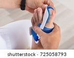 close up of a orthopedist...   Shutterstock . vector #725058793