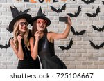 beautiful girls in black... | Shutterstock . vector #725106667